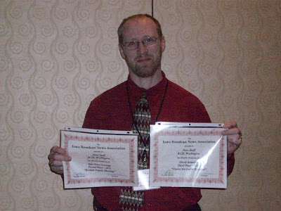 KCII News Director Bill Gatchel presenting two awards won during the 2011 Iowa Broadcast News Association Awards Ceremony