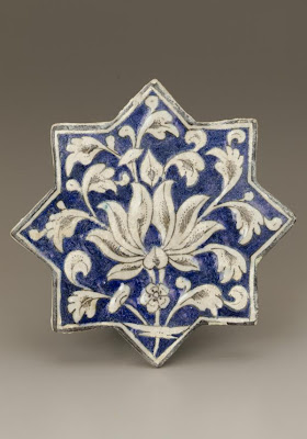 Star-shape tile | Origin:  Iran | Period: early 14th century  Il-Khanid period | Details:  Not Available | Type: Stoneware, composite body painted under clear glaze. | Size: H: 19.7  W: 19.7   D: 1.9  cm | Museum Code: F1999.12 | Photograph and description taken from Freer and the Sackler (Smithsonian) Museums.