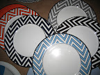 Some Mikasa Color Studio plates in orange, navy, blue, brown, and grey. We loved the geometric pattern.