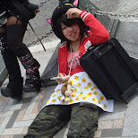 Japanese girl lying down on Jingu birdge in Harajuku, Tokyo, Japan