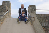 Eidan and my dad on the stone slide at Murphy Field