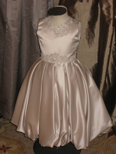 Isn't this flower girl dress from Joan Calabrese beautiful?