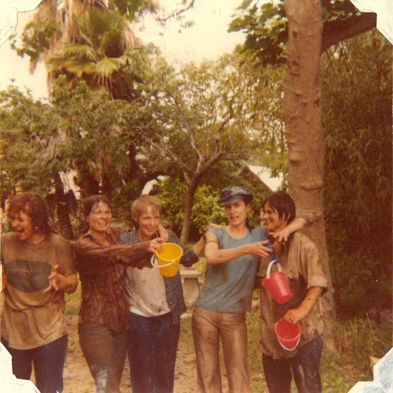 Women following a mud fight on the grounds of the Alcoholism Center for Women. May 1978