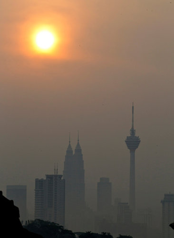 The Petronas Towers in Kuala Lumpur were engulfed in a haze from fires in Indonesia in June 2012. Mark Baker / Associated Press