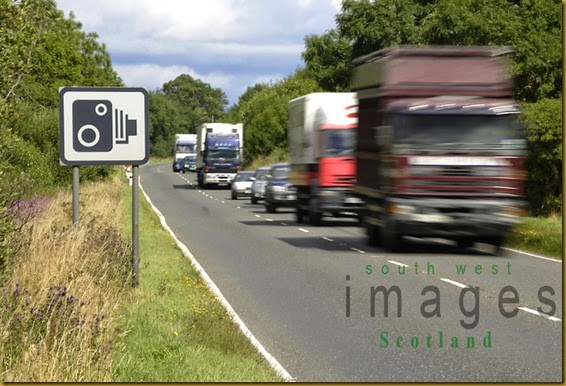 Traffic-passing-speed-camera-sign-UK[1]