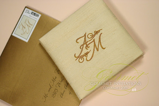 These wedding invitations were made a story book with a silk cover and