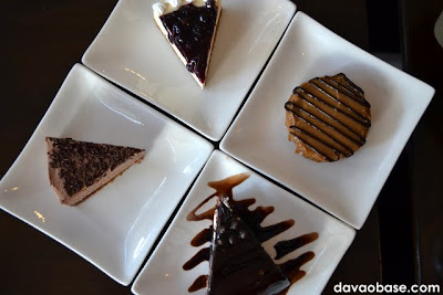 Clockwise from top: Blueberry Cheesecake, Choco Caramel Cake, Chocolate Dome, and Choco Cheesecake. Who will win the clients' tastebuds at Coffee Dream?