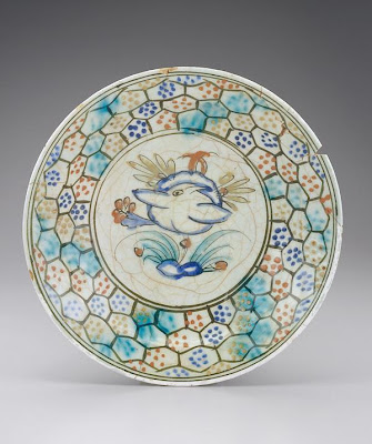 Plate | Origin:  Iran | Period: 17th century  Safavid period | Details:  Not Available | Type: Stone-paste painted under glaze | Size: W: 8.8  cm | Museum Code: S1997.58 | Photograph and description taken from Freer and the Sackler (Smithsonian) Museums.