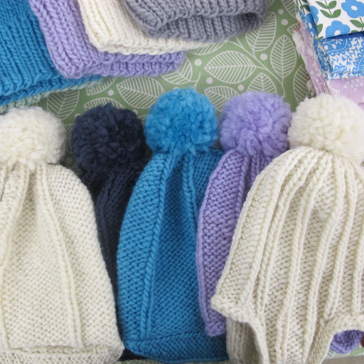 These hats were made using our new Lion Brand yarn.