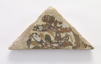 Triangular tile | Origin:  Iran | Period: 19th century? | Details:  Not Available | Type: Stone-paste painted under glaze | Size: H: 21.9  W: 11.1   D: 2.1  cm | Museum Code: F1908.77 | Photograph and description taken from Freer and the Sackler (Smithsonian) Museums.