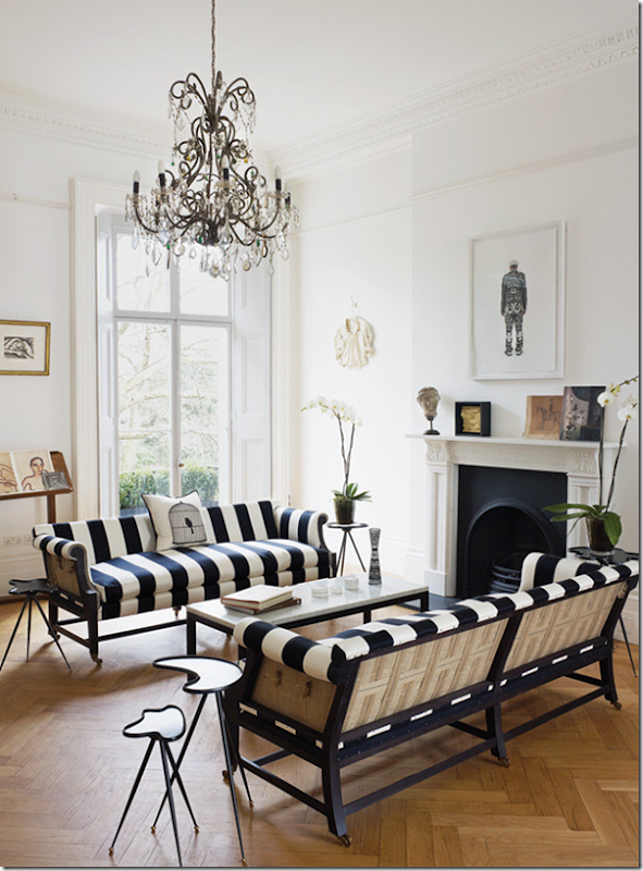An opulent living room with black and white stripe settees -design addict mom