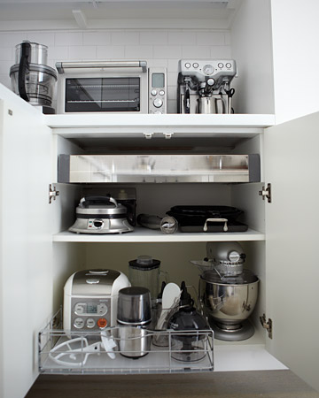 This pull out organizer by simplehuman makes it easy to access my small appliances without having to reach into the cabinet.