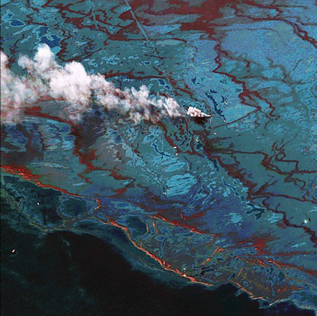 A digitally enhanced satellite image shows the oil spill cleanup effort in the Gulf of Mexico. The image uses the satellite's sensor bands to highlight the oil and dispersant. DigitalGlobe via Reuters