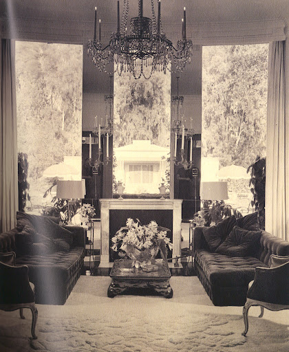James Pendleton bought many of the furnishings for his house from Tony Duquette. Over the living room's mantelpiece, a window overlooking the pool house replaces the conventional mirror over the fireplace. (Regency Redux, Rizzoli)