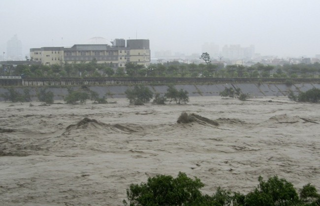 A flooded river is seen after Typhoon Soulik hit Miaoli County, central Taiwan, 13 July 2013. Typhoon Soulik brought powerful winds and heavy rain as it landed in Taiwan early Saturday, killing two and injuring 54. At least 295 people have been confirmed dead or missing after rainstorms and Typhoon Soulik hit China, causing floods, landslides and buildings to collapse. Photo: India Times