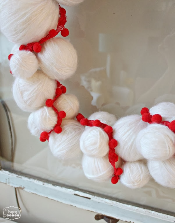 Yarn-Snowball-Christmas-Wreath-with-pom-pom-trim-3-at-thehappyhousie-801x1024