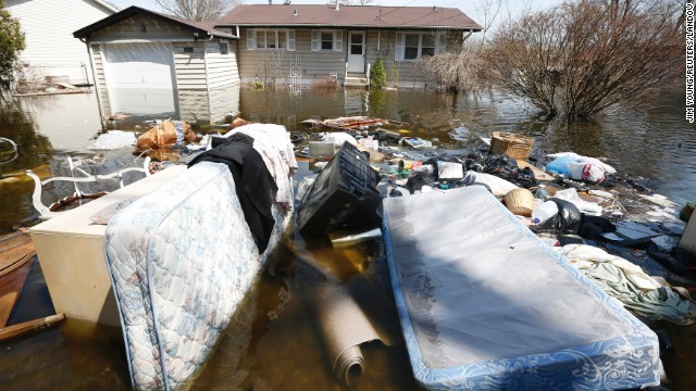 Household items are submerged in floodwaters in front of a house in Fox Lake, Illinois, on Monday, 22 April 2013. Steady rains are expected Tuesday, April 23, in several Midwestern states already facing severe flooding. Photo: CNN