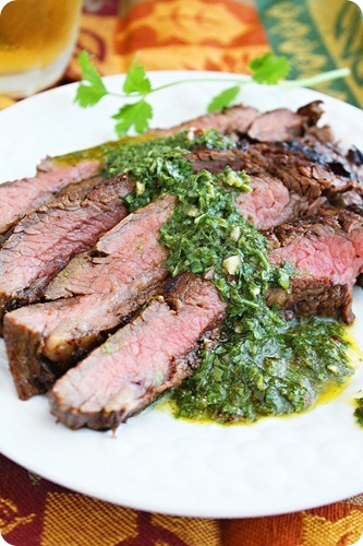 Grilled Marinated Flank Steak with Chimichurri Sauce – Melt-in-your-mouth marinated steak with zesty chimichurri made from fresh herbs. So delicious! | thecomfortofcooking.com