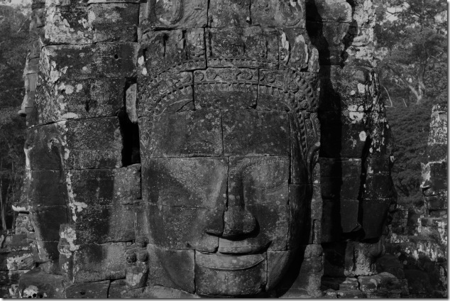 A Smiling Bayon Face surrounded by other faces, Cambodia