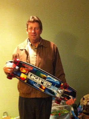 "One of our family friends since our early childhood Mark Ingham with  Bruce's 36"" Logan Earth Ski Gravity made board."