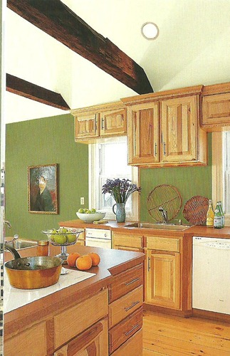 Green paint with wood cabinets