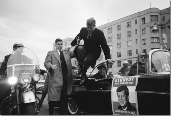 NEW YORK, UNITED STATES - SEPTEMBER 01, 1960: Predidential candidate John F. Kennedy leaping from his car while campaigning. (Photo by Paul Schutzer/Time & Life Pictures/Getty Images)