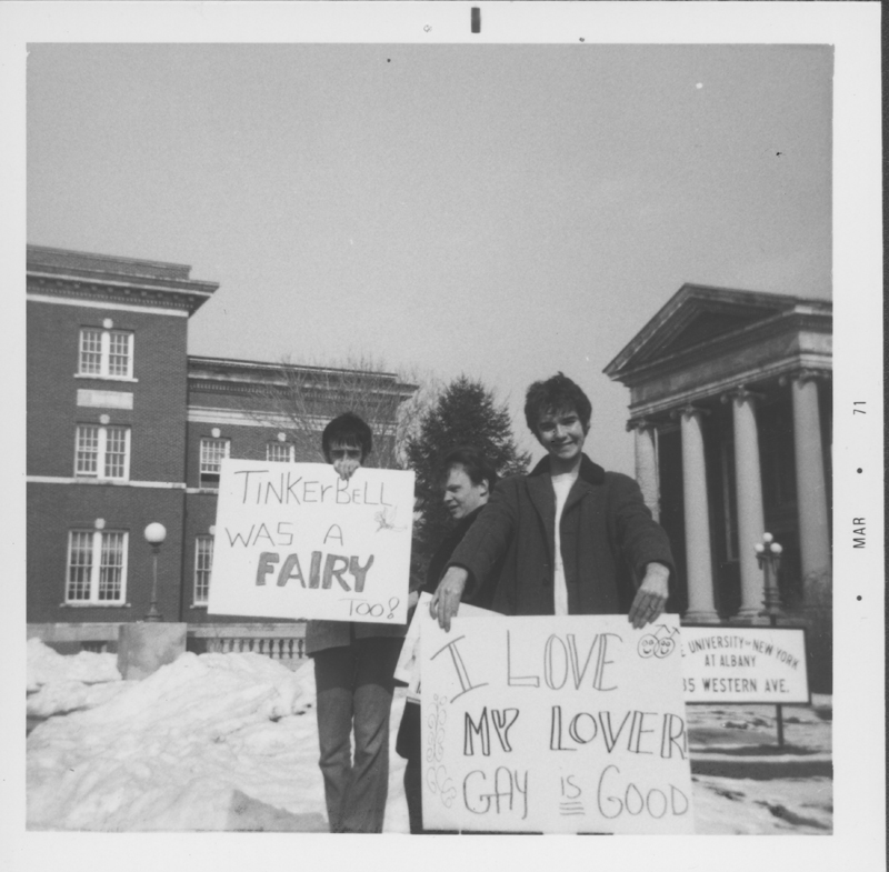 Student gay activists holding signs at a protest at the University at Albany, New York. March 1971.