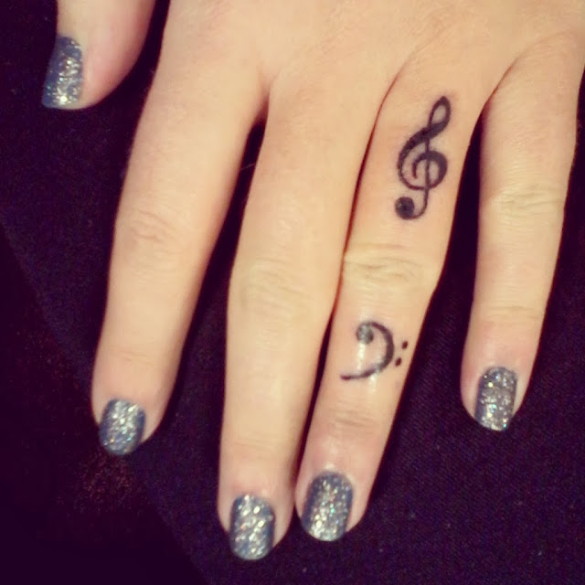 music treble and bass finger tattoos - Raivyn dK hand model