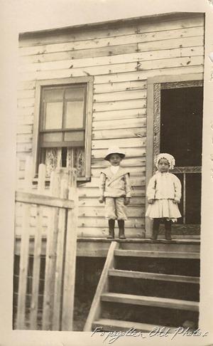 Kids on steps of old building DL Antiques