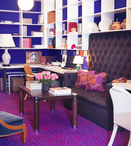 The punch of purples in this room speaks to Liz's bold flavor. I love the crisp white shelving and the subtle animal print on that coffee table.