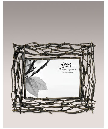 Twig embellishments are really trendy now. This twig frame is a beautiful accessory to a camp-style room.  (horchow.com)