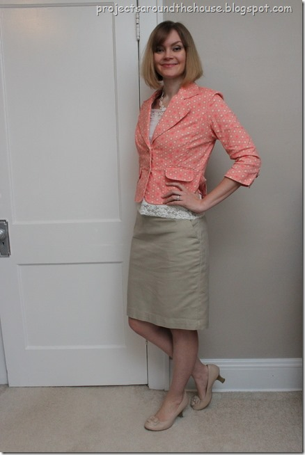 coral blazer and tan skirt