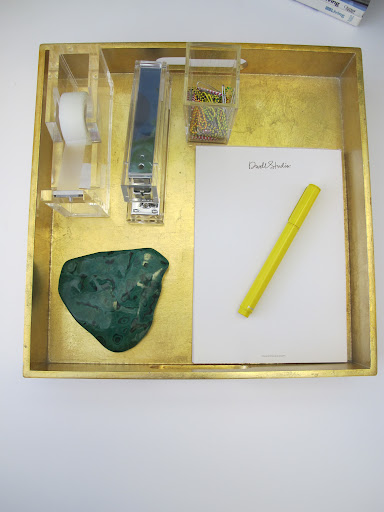 I use the piece of malachite as a paper weight. The yellow pen makes taking notes fun.