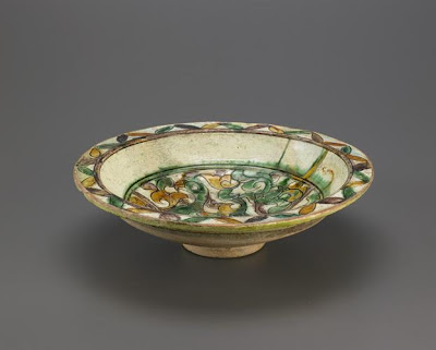 Bowl | Origin:  Syria | Period: 12th-13th century  Ayyubid period | Details:  Not Available | Type: Stone-paste painted and incised under glaze | Size: H: 7.6  W: 28.3  cm | Museum Code: F1942.13 | Photograph and description taken from Freer and the Sackler (Smithsonian) Museums.