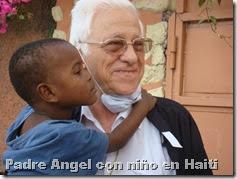 Padre Angel con niño en Haiti