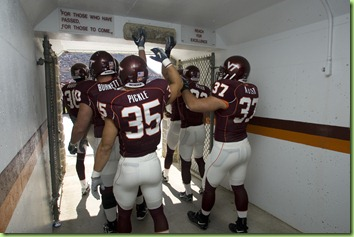 Football players touching Hokie Stone in tunnel; VT vs. Duke