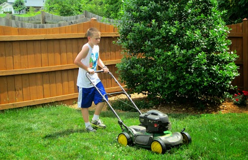 Stephen mows the grass