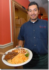 La Cascada owner Ignacio Patino serves up a hearty Mexican meal.