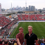 watching the match Toronto FC vs New England Revolution in Toronto, Ontario, Canada