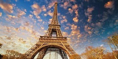 Paris. Beautiful view of Eiffel Tower with sky sunset colors.; Shutterstock ID 122039929; PO: aol; Job: production; Client: drone