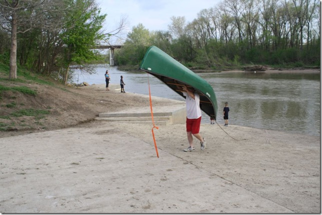 Dan carries canoe out of river Mar 3 2012