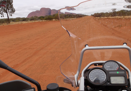 View of the Olgas on the Great Central Road. More importantly note the sandy corrugations on the track. No fun here on a 300 kg BMW GS Adventure. The time on the clock is still WA time.