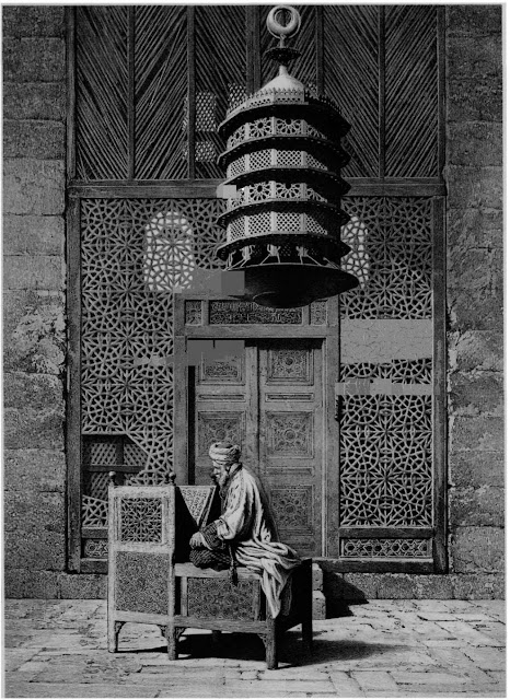 Mausoleum complex of Sultan Barquq, door to the tomb, 14th century. The northern mausoleum, intended for Barquq and his son Faraj, is entered through wooden lattice screens, in front of which sits an intncately carved Quran stand. Carved wood is set against austene