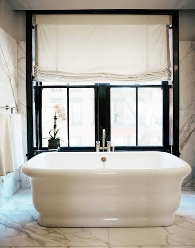 The mix of texture, shape and material really work well together in this bathroom. (decorpad.com)
