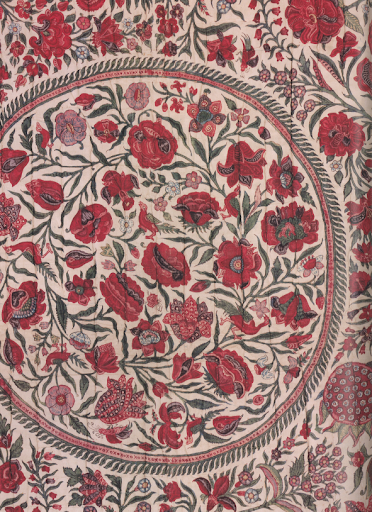 It's like a garden of red poppies covering your bed. Bed cover circa 1700-1725.
