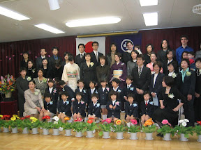 All the kids, parents, and teachers. Kai&#039;s in the middle of the front row, and Maria, Eidan, and I are in the back, on the right.