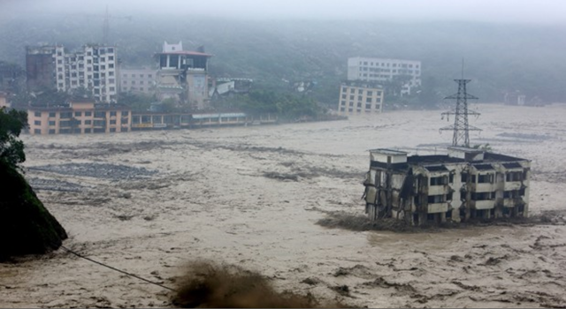 Heavy flood waters sweeping through Beichuan in southwest China's Sichuan province on 9 July 2013. China and Taiwan braced on Friday for the impact of Typhoon Soulik as the toll of dead and missing from torrential rain across a broad swathe of China continues to grow. Photo: AFP / Getty