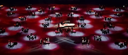 Piano players perform during a celebration of Russian music. (Matthew Stockman/Getty Images)