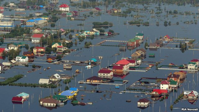 The flooded settlement of Vladimirskoye in the Amur region of Russia's Far East, 25 August 2013. Over 50,000 people have been affected by the disaster, which is considered Russia's worst flooding in 120 years. Photo: RIA Novosti