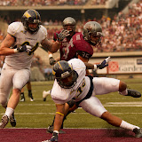 Montana&#039;s Dan Moore powers into the endzone early in the 2nd quarter, trucking his way past NAU&#039;s Lucky Dozier to make the score 24-7.  Washington-Grizzly Stadium in Missoula, MT, Sept. 22nd, 2012.